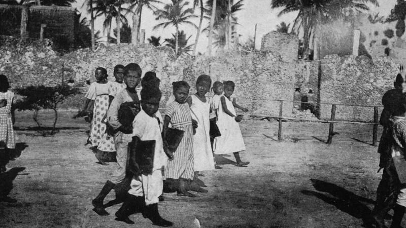 Children walking to school on Rota, 1921 (Junius B. Wood)