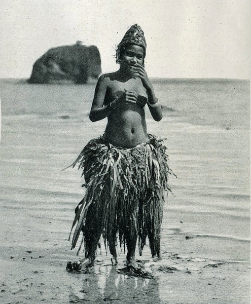 "From ""The Illustrated London News"" of 24 April 1937:  ""After the bathe:  A native girl in her heavy grass skirt, which may weigh 30 lb. even when not soaked with sea-water."""