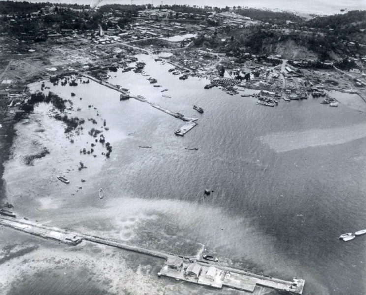 A U.S. Navy photograph of boats anchored in a Dublon (now 'Tonowas') harbor a few days before a U.S. bomber strike on the same area on April 29 and 30, 1944.