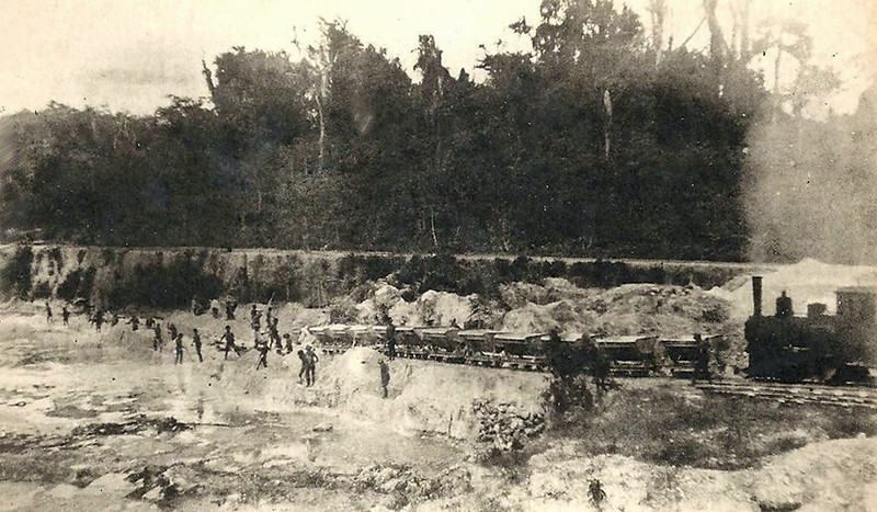 During the period of Japan's South Seas Mandate, a photograph showing men mining for phosphate on Angaur; a small steam locomotive pulls the tram cars holding the mineral