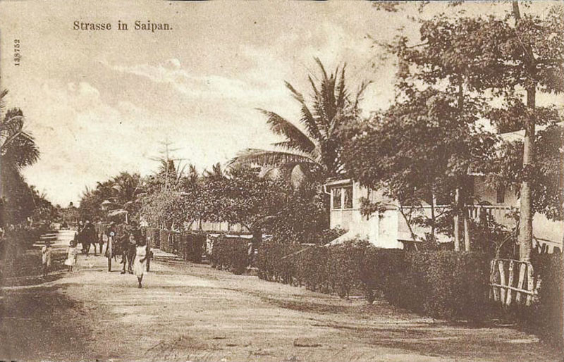 A postcard photograph, circa 1910, of a street in Saipan from the period of German rule in Micronesia.