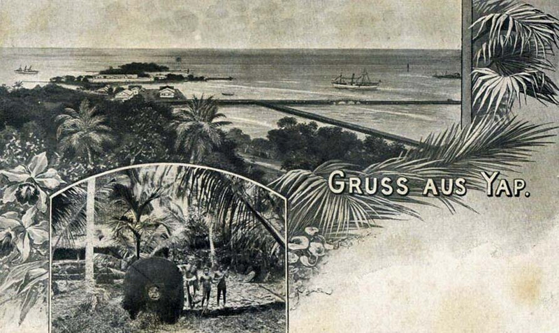 "This image from about 1900 on a German postcard combines what appears to be a painting of Colonia and its harbor from the hill above the town, as well as an actual photograph of a village scene showing a man and two boys standing beside a large piece of stone money.  The German caption says ""Greetings from Yap.""  Other words on the postcard indicate that it was made by ""C. Jacobson's Fine Arts Printing Works, Altenburg, S.-A..""  ""S.-A."" is an abbreviation for the former duchy of Sachsen-Altenburg, now part of the German State of Thurigia."