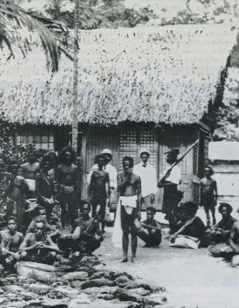 A group of Palauan men, as well as members of the local police force, during the German period (Augustin Kramer, 1909)