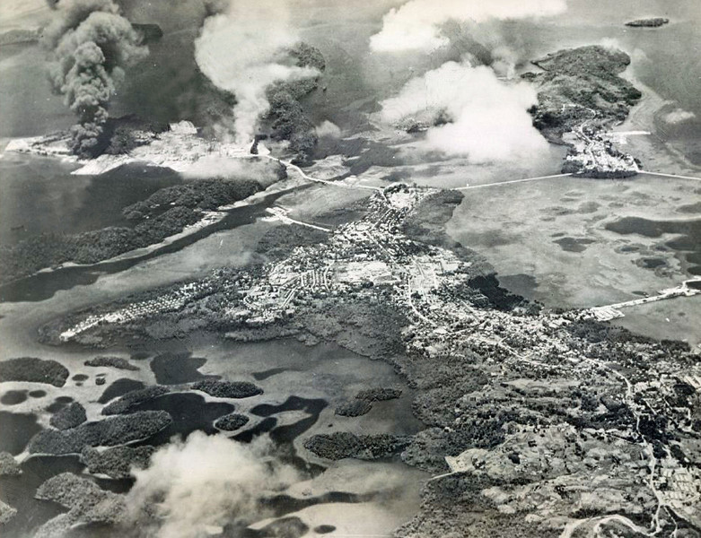 Smoke rising after air strikes on the Japanese base on Koror by Pacific Fleet carrier planes on 29-30 March 1944