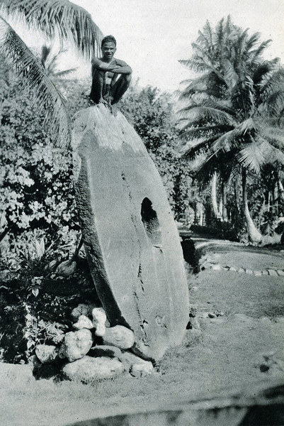"From ""The Illustrated London News"" of 24 April 1937:  ""A colossal 'coin' 12 ft. in diameter and 'beyond price,' with a man seated on the top of it; one of the largest pieces of the unique stone money used in the island of Yap."""
