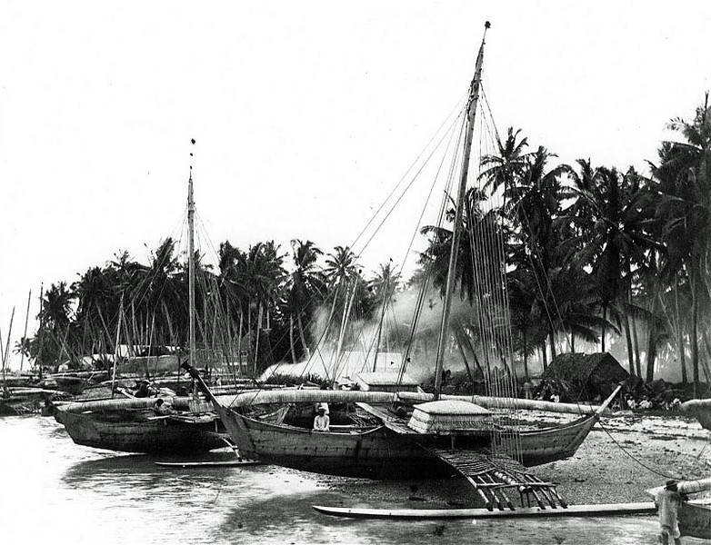 Marshall Islands:  Several outrigger canoes on Jaluit, circa 1900