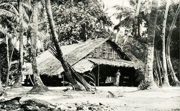 This is a photograph of a guesthouse on an island in the Chuuk Lagoon, taken in 1921 by Junius B. Wood.