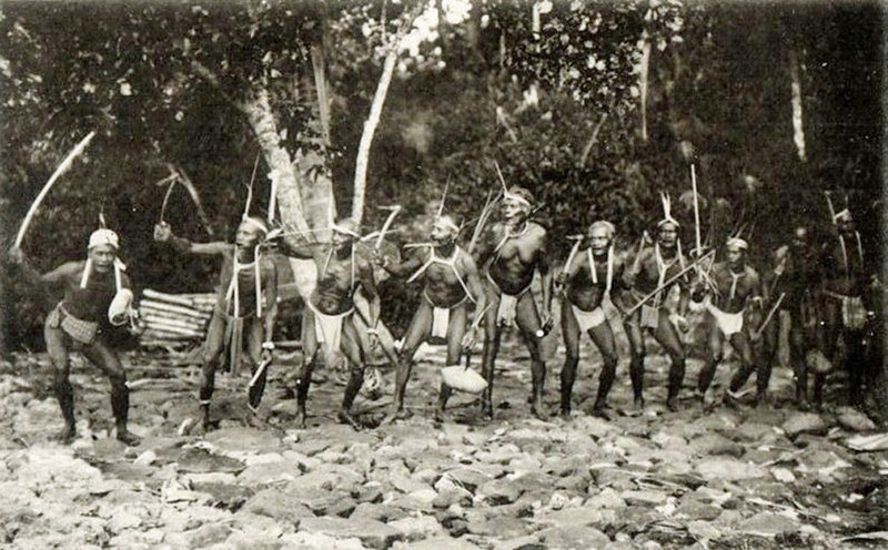 In this photograph from the period of Japan's South Seas Mandate, circa 1930, a group of Palauan men perform a standing dance