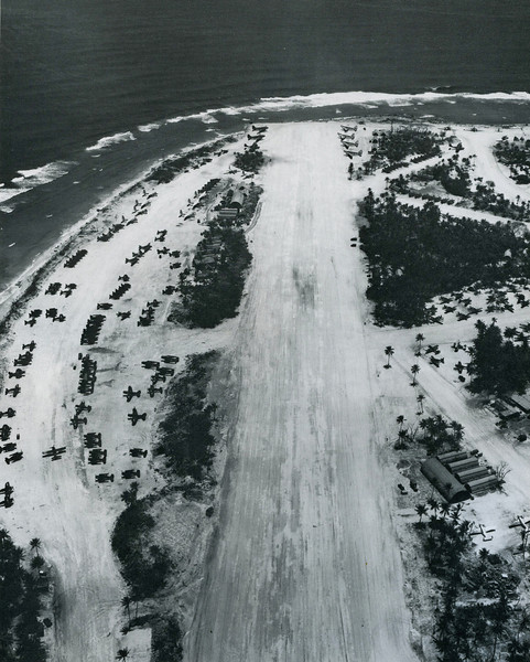 American planes lining the 3,500-foot airstrip (enlarged by Seabees from a smaller Japanese strip) on Falalop, Ulithi (U.S. Navy, National Archives)