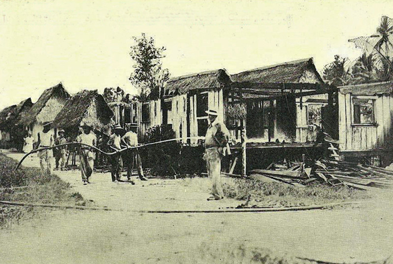 In the foreground, the Fire Chief of Guam, on the scene after a fire (about 1910)