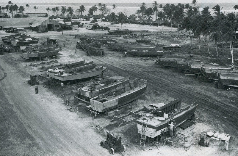 Plywood landing craft on sawhorses being repaired by Navy shipwrights on Ulithi (U.S. Navy, National Archives)