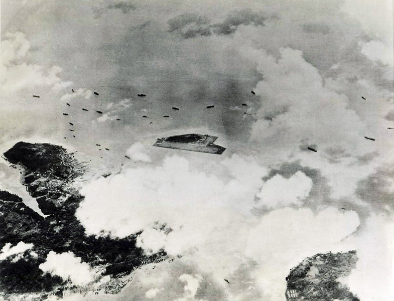 An aerial photograph of Japanese warships in the Truk (Chuuk) Lagoon, taken through heavy cloud cover by a Marine photo-plane, the first U.S. reconnaissance flight over the islands, in February 1944.  Truk was Japan's principal air and sea base in the Central Pacific.