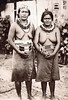 Two women in traditional dress on Saipan, about 1920