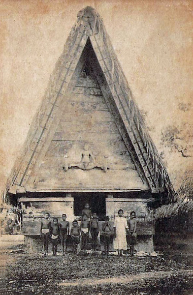 From the period of Japan's South Seas Mandate, a group of Palauan children photographed in front of a chief's house (early 1920s).  The carved figure over the doorway represents a legendary woman named Dilukai, who was the sister of an island troublemaker named Atmatuyuk.  He eventually left and, to ward against his return, islanders prominently placed the sister's naked and salacious image over the doorway to each chief's house, since it was taboo for a brother to look at the genitalia of a sister.