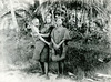 Chuuk, 1899:  Henry Clifford Fassett photograph of infant and two young women in traditional dress in front of a nearby thatch house