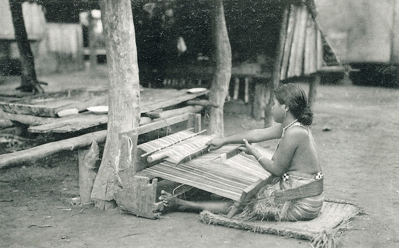 A woman on Saipan weaves a lava-lava, about 1920