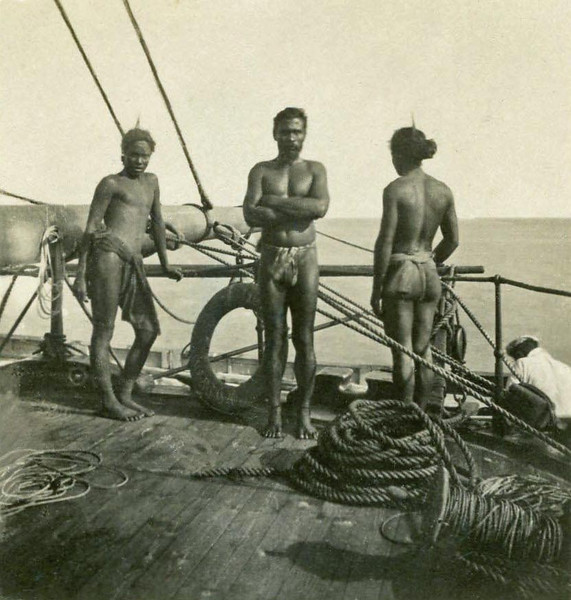 Three islanders on the deck of a German ship, anchored off Koror; below on the far right, one of the ship's crew members (Kurt Boeck, 1900)