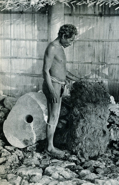 "From ""The Illustrated London News"" of 24 April 1937:  ""A Yap householder and his 'money:  (left) a large stone piece, kept outside the house; (right) a bundle of cloth garments called 'lava-lavas,' used as currency."""