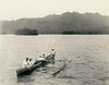 Kosrae, 1899:  Photograph by Henry Clifford Fassett showing four men paddling an outrigger canoe