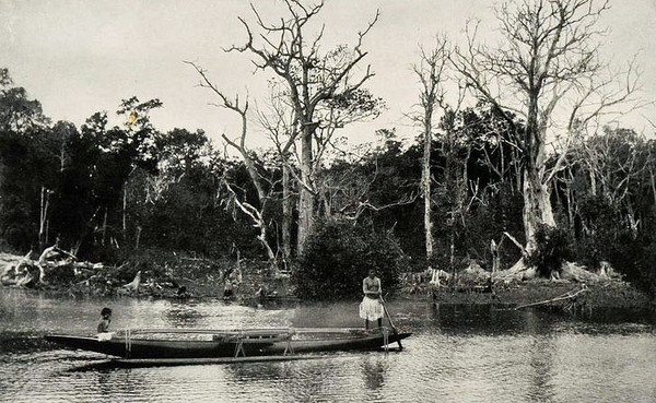 Pohnpei, 1899:  Photograph by Henry Clifford Fassett showing islanders on an outrigger canoe in the Kitti River