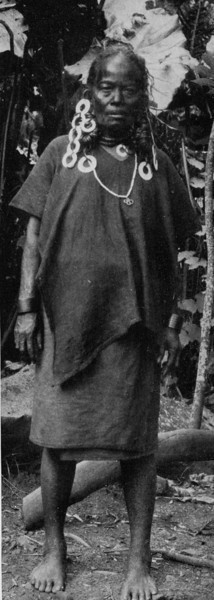 A Chuukese woman, wearing a poncho-like top for a visit to the island center, 1921 (Junius B. Wood)