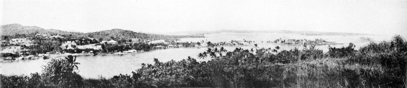 This panoramic view of Colonia, Yap, and its harbor results from assembling all three separate postcard photographs of portions of the view.