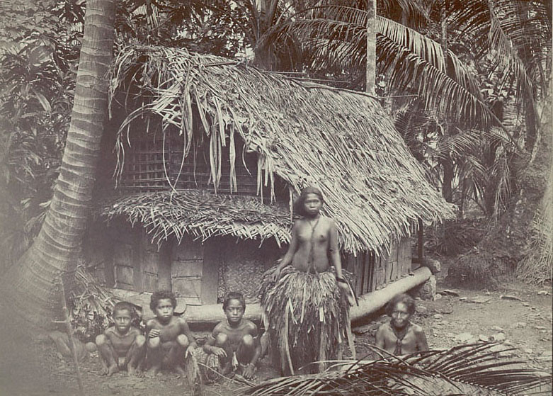 Yap, 1893:  Photograph by Isaac B. Millner showing two women and three boys in front of a thatch house