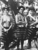 Three young Ulithi women wearing traditional lava-lavas, in a photograph taken by a U.S. soldier on the atoll in 1944
