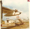 "I found this amazing photo on a great Coast Guard site:   <a href=""http://www.fredsplace.org"">http://www.fredsplace.org</a>.  It shows a Coast Guard C-123 transport plane being refueled on Yap sometime in the mid- to late-60s.  The Yap Loran Station section of Fred's Place has many reminiscences by guys who were there, but only 5 photos, the last time I looked.  This one really caught my attention, not only because of the refueling technique, but the Mobil sign, boarding-stair truck, bright sunlight, and water puddles on the ground:  you just know how hot and humid it's got to have been out at that airstrip that day.  I tried to get permission to use the photo, but there was no photgrapher information listed.  I wrote the site but got no response.  Which is really not surprising, since Fred's Place is a VERY large site.  Anyway, until someone asks me to take it down, I thought those of you who were on Yap back then might appreciate it."