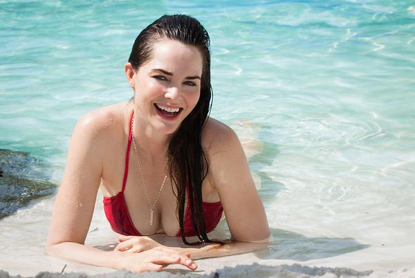 Beautiful happy woman in bikin on beach