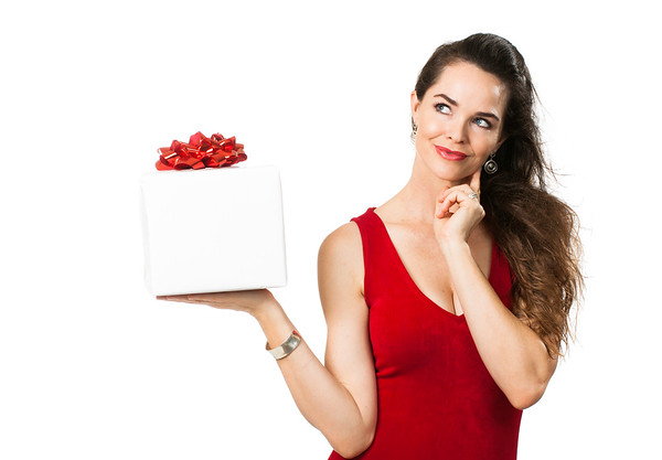 Pensive woman holding wrapped gift