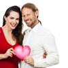 Happy couple holding love heart