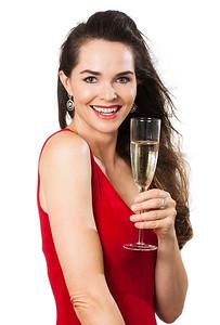 Beautiful woman holding glass of wine