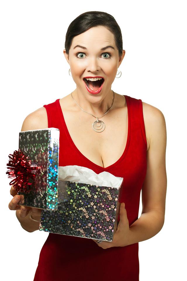 Beautiful young woman opening gift box