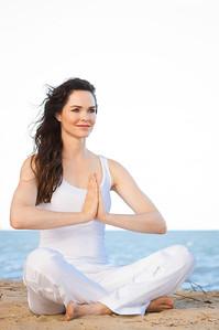 Beautiful fit young woman meditating