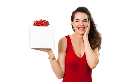 Beautiful surprised woman holding gift.