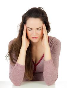 Beautiful woman suffering from headache