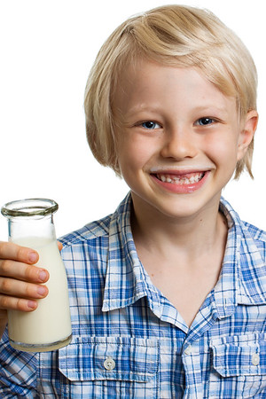 Cute boywith milk moustache and bottle