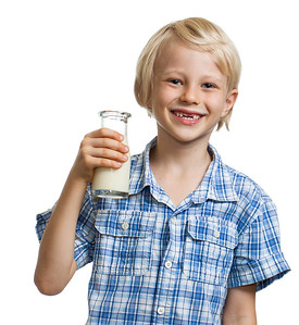 Laughing boy holding bottle of milk.