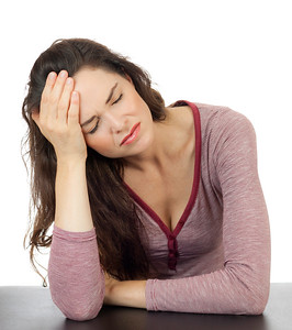 Beautiful woman with terrible headache