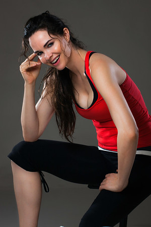 Smiling woman having a rest from exercise