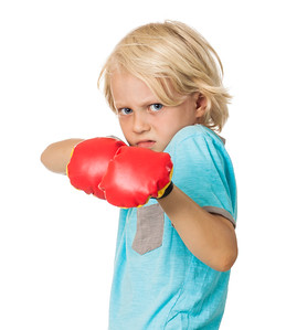 Scared angry boy with boxing gloves