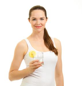 Beautiful woman holding glass of water