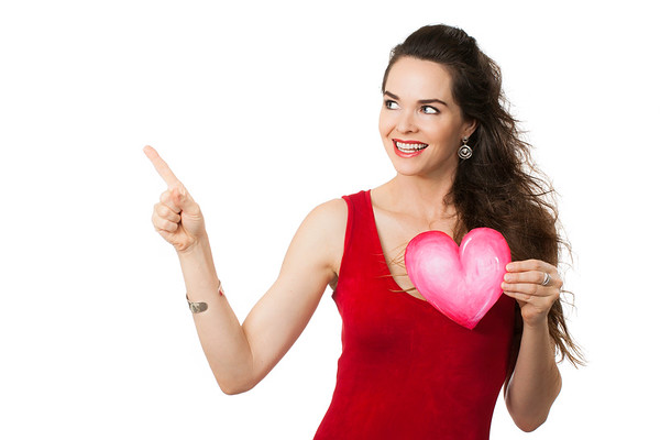 Smiling woman holding a love heart