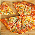 Homemade pizza on chopping board