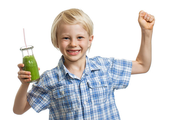 Healthy boy with green smoothie