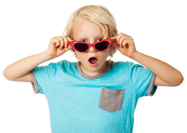 Surprised young boy wearing sunglasses