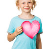 Sweet young boy holding love heart