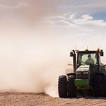 Tractor in a dusty dry farm
