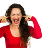 Frustrated woman covering her ears